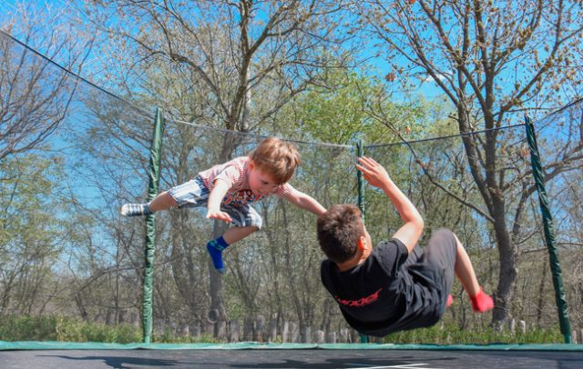 Children playing on a trampoline